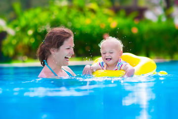 Mom and child swimming