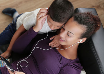 mom and son listening to music