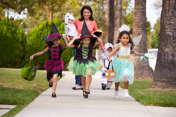 girls going trick-or-treating on halloween