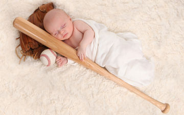 baby with baseball and bat
