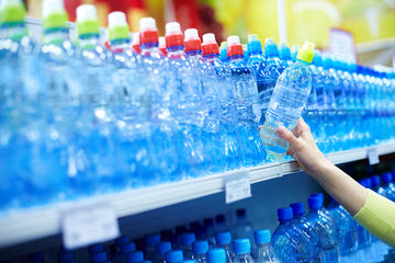 woman buying bottled water