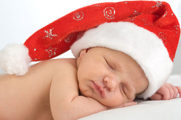 sleeping baby in Santa hat