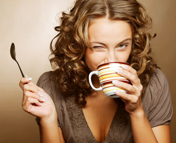 woman drinking coffee and winking