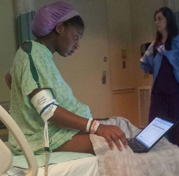 Woman in labor taking exam