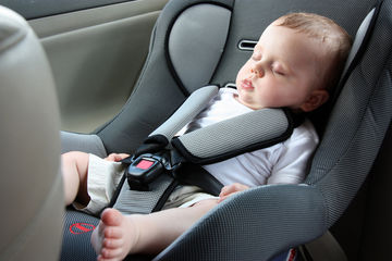Baby in a forward-facing car seat
