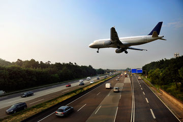 Plane flying over a highway