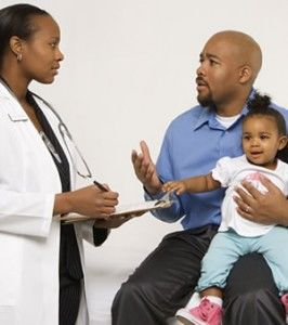 Pediatrician Talking with a Parent