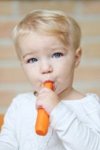 girl eating carrot