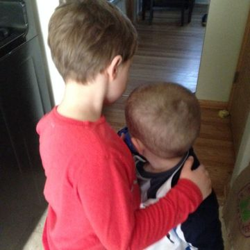 Liam hugging his brother