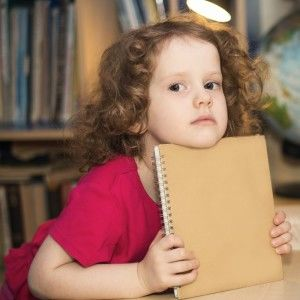 girl holding a notebook