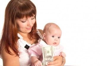 mom holding money and baby