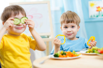 Kids enjoying veggies