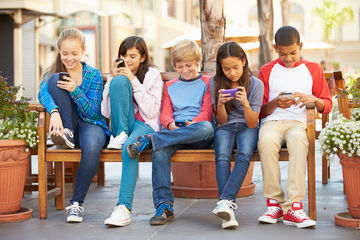 Group of kids texting