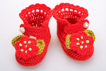 Red crochet booties for a girl