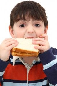hungry boy eating sandwich