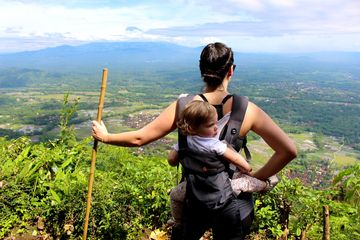 Erica Weber Carrying Daughter on Back Indonesia Hike