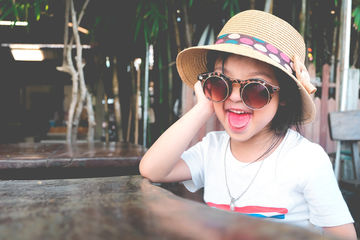 little girl wearing silly sunglasses