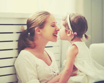 Mom and Daughter Touching Noses
