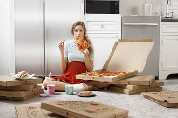 Pregnant Woman Eating Pizza Cropped