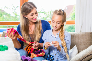 mom and daughter knitting