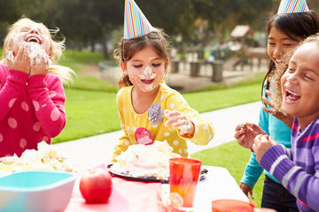 Kids at Birthday Party with Cake on Faces