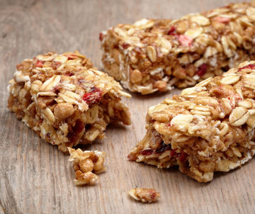 Granola bars on natural background