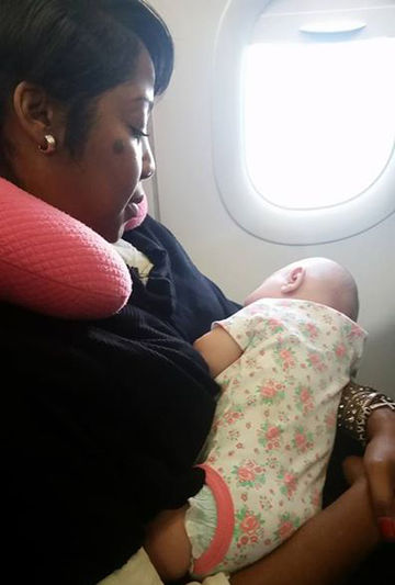 nyfesha miller with baby on plane