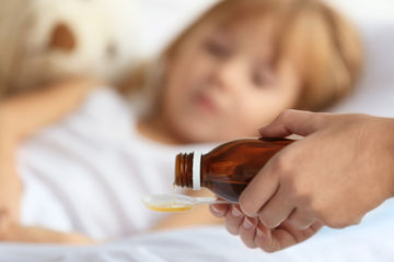 pouring cough syrup with codeine for child