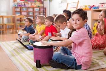 preschool kids playing drums