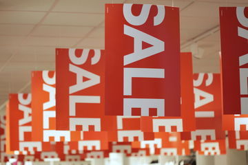 sale signs hanging in store
