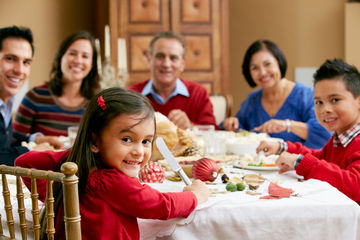 Family sitting at holiday dinner table