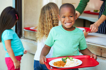 Young Boy With Healthy School Lunch