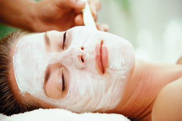 Woman getting spa facial treatment