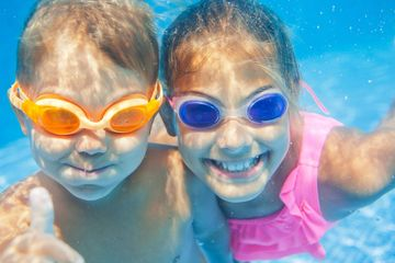 Two kids underwater