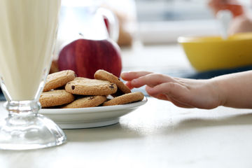 child hand reaching for cookies
