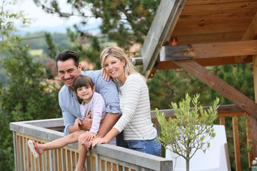family staying in log cabin