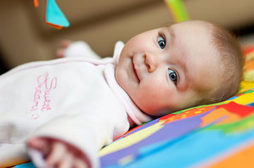 Four Baby Exercises Smiling Baby Laying On Back