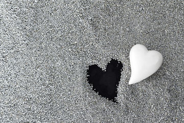 Two hearts in the sand black and white