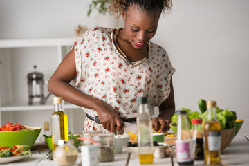 Woman in Floral Shirt Cooking