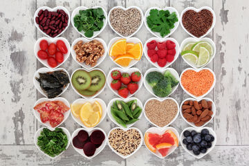 Healthy foods in heart-shaped containers