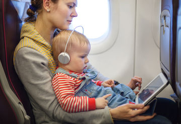 mom and baby using iPad on plane