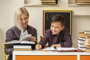 School tutor with young boy student