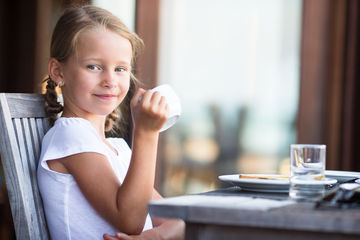Girl with Pigtails Drinking Tea