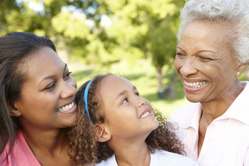 Grandmother, mom and daughter smiling