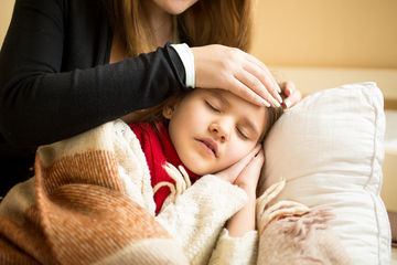 Soothing Sick Kids Girl Laying With Mother