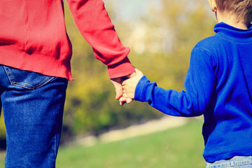 A Ha Moment Adult Holding Childs Hand