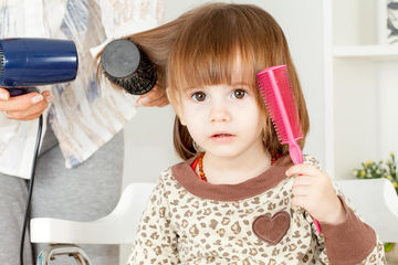 young girl brushing her hair