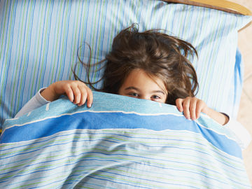 Child Hiding Under Covers