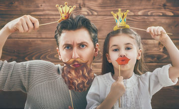 Dad and daughter with photo booth props
