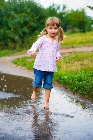 Little Things Girl Playing In Rain Puddle Barefoot